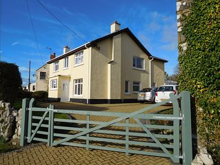 A comfortable spacious 5 bedroom 3.5 bathroom detached house with sea views.
