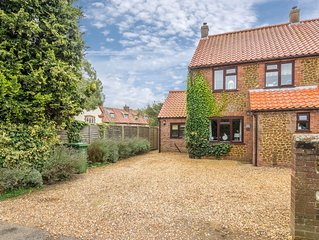 A beautifully presented four-bedroom holiday home near Holme Beach.