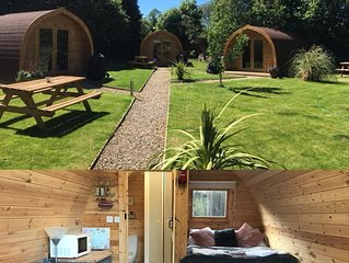 Luxury cosy  glamping pods set within a secret garden setting