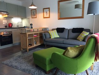 South-facing ground floor apartment in tranquil area near village centre