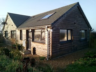 Eco-build, light filled, oak clad annex, with parking and private gardens