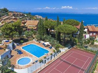 Appartamento in esclusivo residence con piscine, tennis e parcheggio privato
