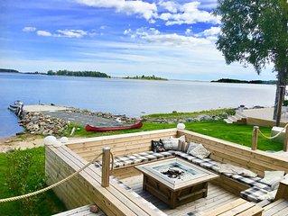 Luxurious seafront-villa with private beach, jacuzzi, mini-tenniscourt & sauna