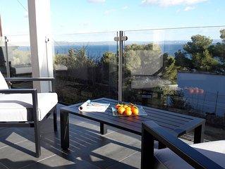 Neues, helles Haus mit schöner Aussicht & Balkon, unmittelbarer Strandnähe
