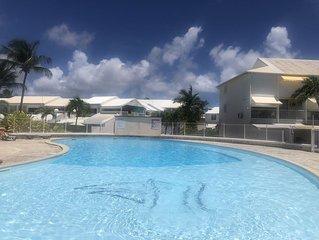Nouveau : Studio dans résidence avec 3 piscines vue sur la Marina de St François