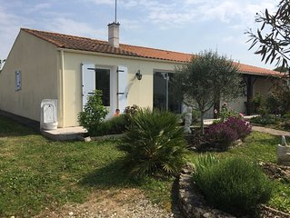 Maison de plain pied avec jardin clos aux portes de l'île d'Oléron