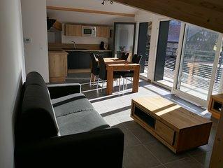 Appartement neuf dans résidence calme entre lac et montagnes