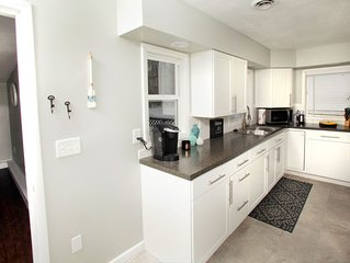 Spacious home steps away from 'The Strip' in GOTL with 1 acre of seclusion!