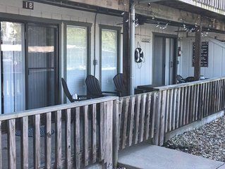 Ground level condo steps from the pool on the lake. Boat slip available