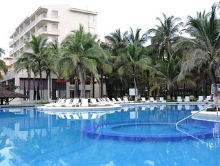 Flamingos beachfront one bedroom condominium with hotel services