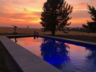 Poolside sunsets and private country estate, close to town