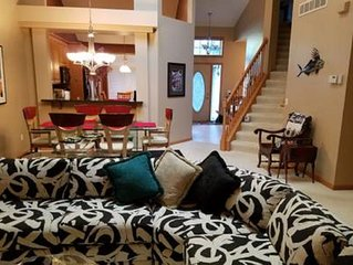Main floor LR, DR, Kit, Entryway, photo taken from the TV room with 58' TV