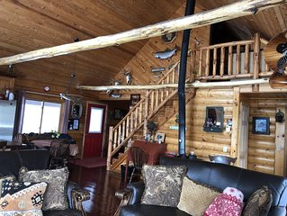 Private lakefront  log home has amazing views with  UTV trail access.