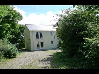 Secluded large modern house with self contained private garden and own lane