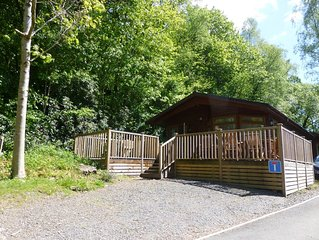 Luxury lodge set in 60 acres of wooded parkland with fell views and lake access