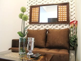Cozy WINDcondo in COOLsuites with greenery view
