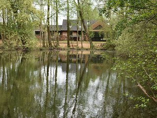 Superb lakeside Lodge in a stunning setting with its own hot tub and sauna