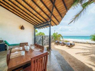 Blue Parrot Beach Villa Righ on the white sand beach,