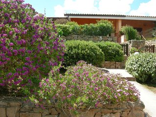 Villetta a schiera ,cielo terra, con giardino privato, due letto e due bagni