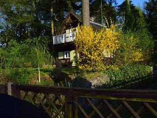 Romantisches Haus mit Seeblick für 4 Personen .Kostenloses WLAN. Großer Garten