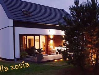 House near the lake; 4 bedrooms; 145 m² building area; 1300 m² real estate