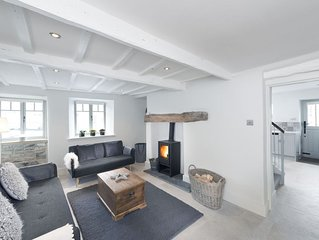 Cosy contemporary  cottage in village with own courtyard & original features.