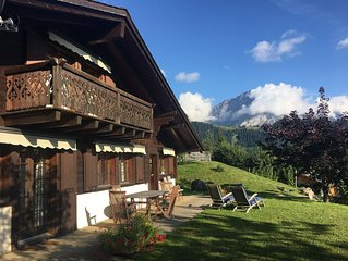 Luxurious ski in/ski out classical Swiss mountain chalet with outstanding views