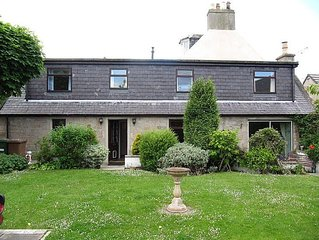 The Hollies. Family and disabled friendly traditional stone cottage with garden.