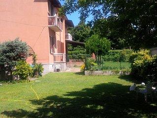 Appartamento in splendido casale con giardino privato