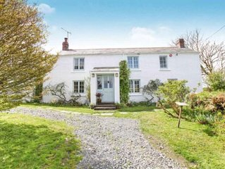 Stylish secluded cottage with extensive private gardens and distant sea views