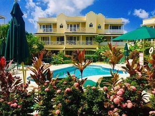 Attractive poolside condo opposite beach.