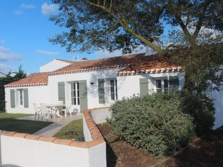 Maison de plein pied avec jardin  proche du centre ville et à 1 km des plages