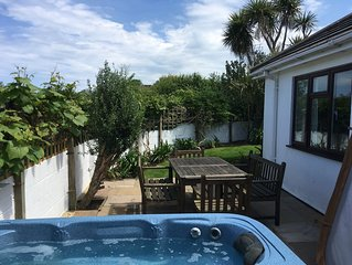 Beautiful ground floor apartment with sun terrace, garden and Hot Tub
