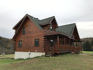 Rustic log home on 4.79 acres