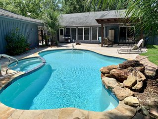A tropical island paradise with a heated salt water pool that is open all year