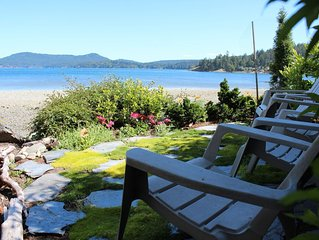 Private cottage with hot tub in lush garden setting on beautiful waterfront