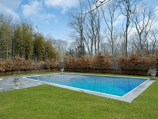 Delightful home with beautiful lawn and heated pool