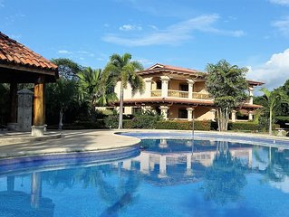Luxury Condo with Large Pool, walking distance to beach to pristine Beach.