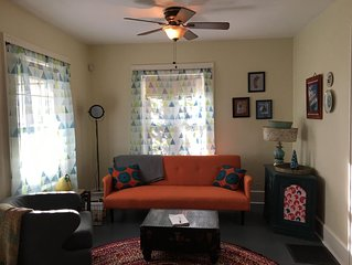 Quirky, bright cottage full of art and fun touches in walkable neighborhood