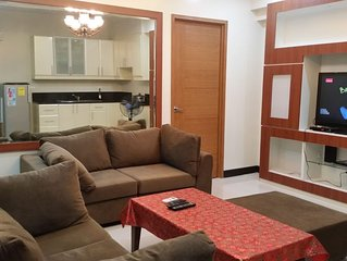 Fully Furnished, Elegant Condominium unit with Free Parking and Wifi