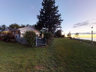 Beautiful cottage on 17 secluded acres fronting Lake Ontario. Peaceful, private.