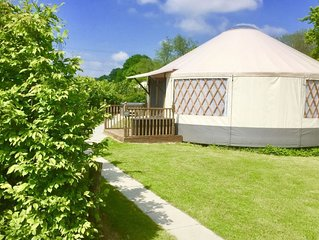 Oak Yurt is a high quality luxury yurt with large windows, French doors and a be