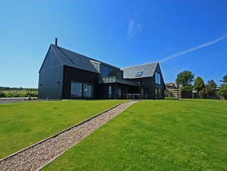 Spectacular uninterrupted views of Loch Fleet and the countryside from every roo