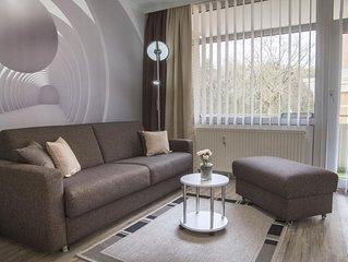 FP 104 - Moderne Ferienwohnung in Strandnähe mit Schwimmbad und Sauna im Haus, f