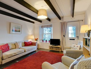 Beautiful holiday home in Wadebridge with a fireplace in the bedroom and a lovel