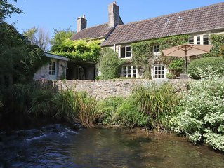 Relax to the sound of the river by our quintessentially English country cottage