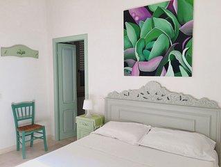 Appartamento fronte mare con giardino