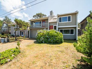 Cozy family home less than a block from secluded beaches in the village!