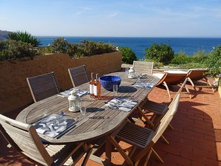 Seaside property with sun terrace, local beach and stunning sea views