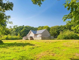 A delightful lodge with hot tub on Wakes Hall Farm is a haven of peace in 500 ac